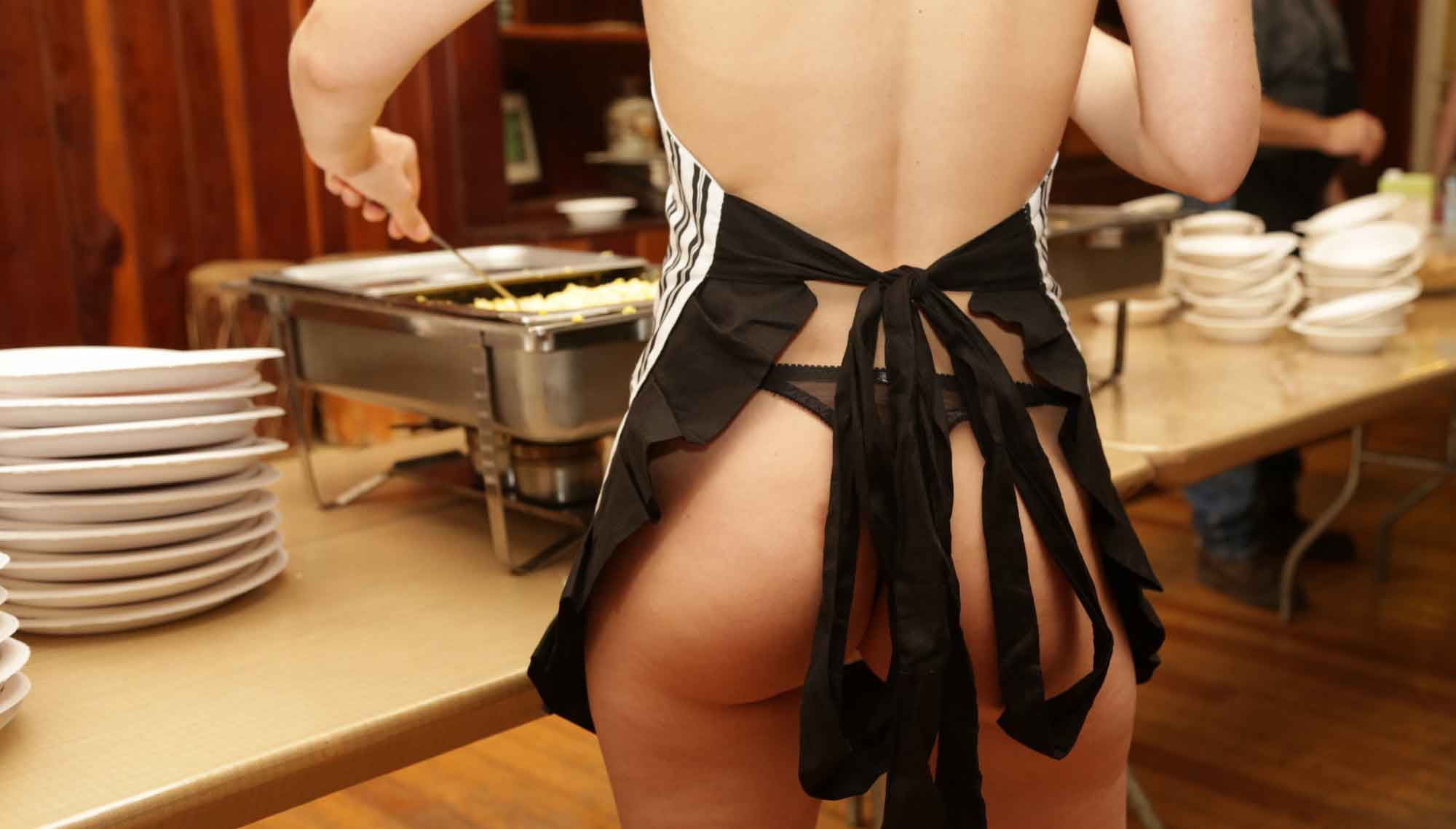 Boundless scantily clad person serving food
